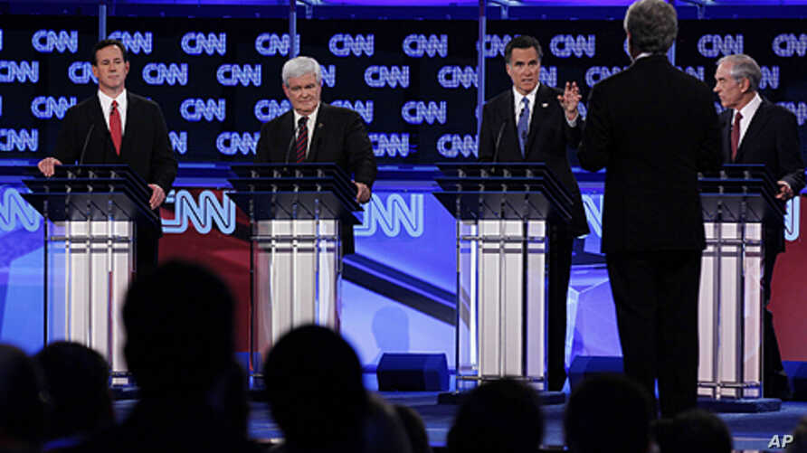 Republican presidential candidates, from left, former Pennsylvania Sen. Rick Santorum, former House Speaker Newt Gingrich, former Massachusetts Gov. Mitt Romney and Rep. Ron Paul, R-Texas, look toward moderator Wolf Blitzer of CNN as they participate