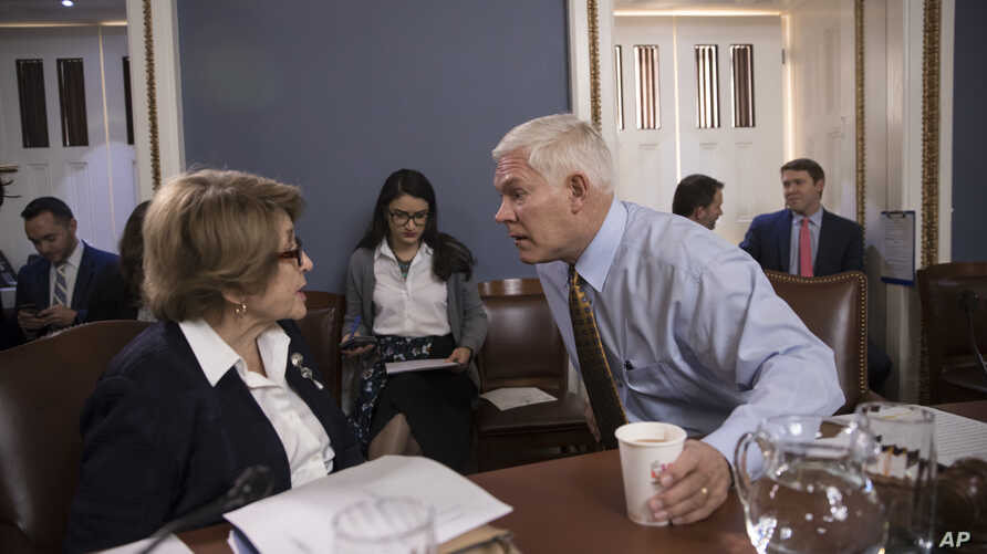 House Rules Committee Chairman Pete Sessions, center, confers with Rep. Louise Slaughter, the top Democrat, as the panel meets on Capitol Hill in Washington, Dec. 21, 2017.