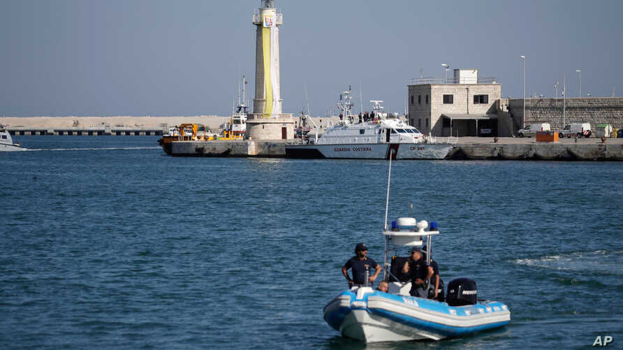 FILE - Italian police patrol a port in southern Italy, April 20, 2018.
