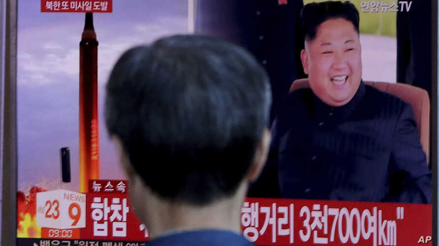 A man watches a TV screen showing file footage of North Korea's missile launch and North Korean leader Kim Jong Un, at the Seoul Railway Station in Seoul, South Korea, Sept. 15, 2017.