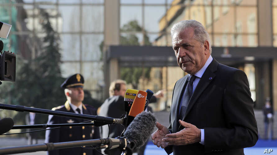 FILE - EU Migration Commissioner Dimitris Avramopoulos answers reporters' questions as he arrives for a meeting of interior ministers of the central Mediterranean contact group on migration in Rome, Italy, March 20, 2017.
