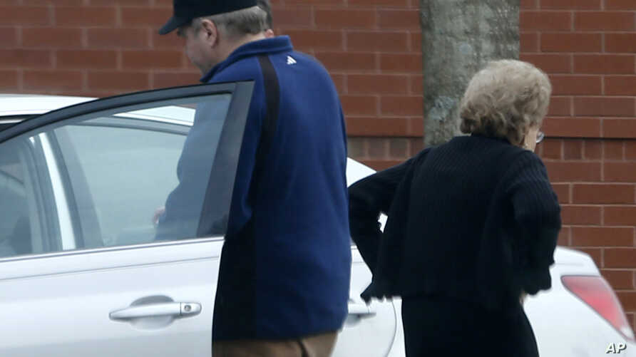 FILE - John Hinckley (L) gets into his mother's car in front of a recreation center during a sanctioned visit with her, in Williamsburg, Virginia, March 19, 2015.