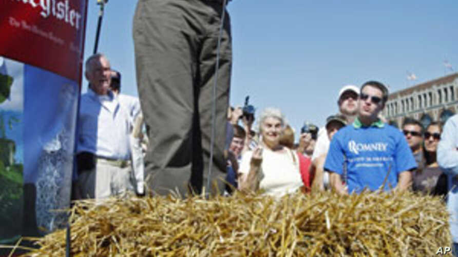 US presidential candidate Mitt Romney campaigns in Iowa, Aug. 11, 2011