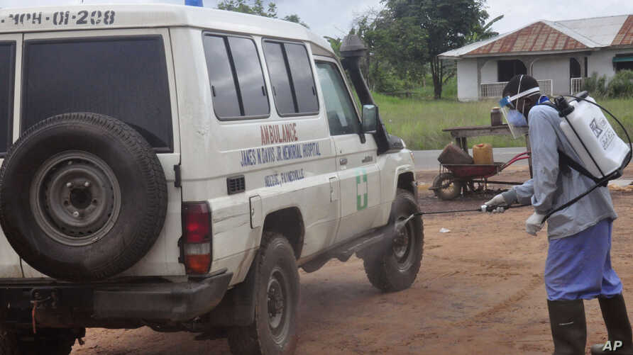 Ebola health workers spray disinfectant on an ambulance that was used to transport   two people suspected of having the Ebola virus  on the outskirts of Monrovia, Liberia, July 1, 2015.
