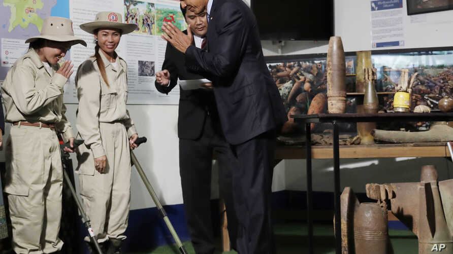 U.S. President Barack Obama greets workers in a tour displaying tools used to clear land of unexploded ordnance at the Cooperative Orthotic and Prosthetic Enterprise (COPE) Visitor Centre in Vientiane, Laos, Wednesday, Sept. 7, 2016.
