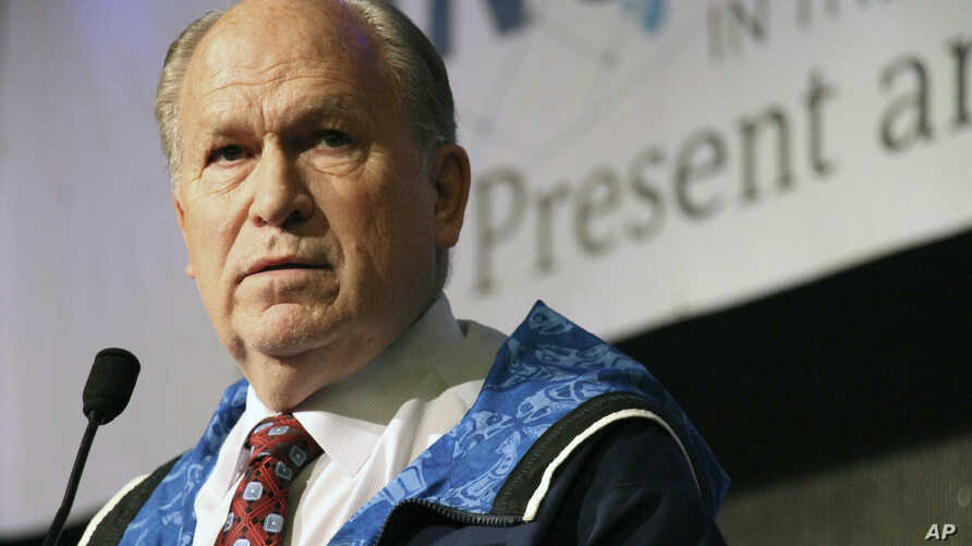Alaska Gov. Bill Walker announces he will drop his re-election bid while addressing the Alaska Federation of Natives conference, Oct. 19, 2018, in Anchorage, Alaska. Walker's re-election plans were dealt a blow earlier in the week after his running m
