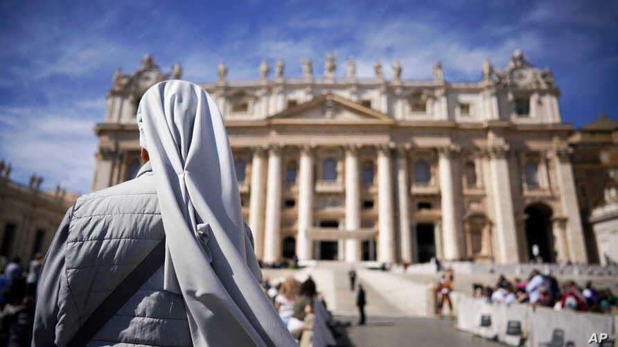 "FILE - A nun waits for the arrival of Pope Francis for his weekly general audience, in St. Peter's Square at the Vatican, Sept. 26, 2018. The Catholic Church's global organization of nuns has denounced the ""culture of silence and secrecy"" surrounding"