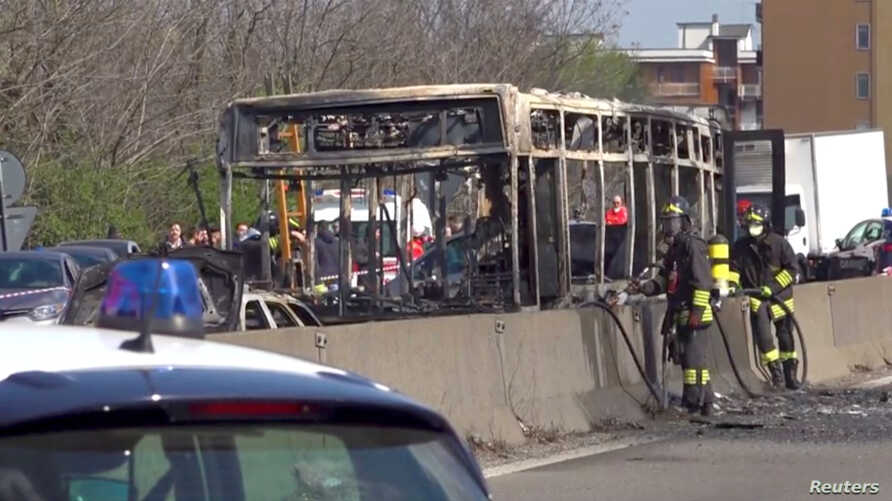 The wreckage of a bus that was set ablaze by its driver in and act of protest is seen on a road near Milan, Italy, March 20, 2019.
