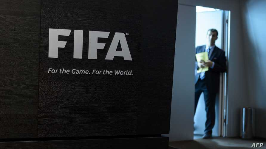 Employee waits prior to a press conference at the FIFA heaquarters on May 27, 2015 in Zurich.