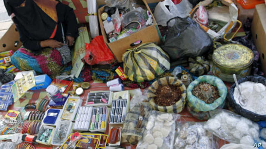 A Libyan woman sells traditional products at a stall along a street in downtown Tripoli, Libya, October 30, 2011.