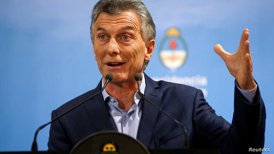 Argentina's President Mauricio Macri gestures during a news conference at the Olivos Presidential Residence in Buenos Aires, May 16, 2018.
