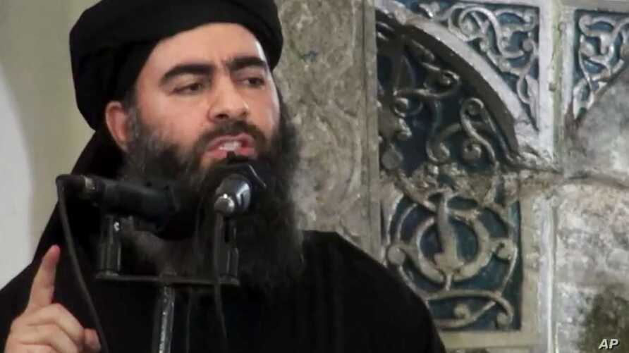 FILE - This image taken from a militant website July 5, 2014, purports to show the leader of the Islamic State group, Abu Bakr al-Baghdadi, who released a new message late Wednesday, encouraging his followers to keep up the fight for the city of Mosu