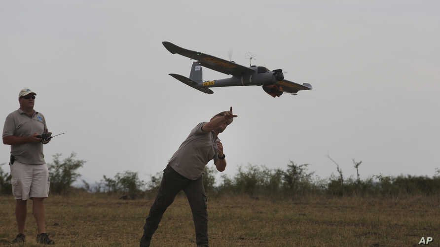 FILE - In this file photo taken Monday, Feb. 15, 2016, a drone is launched in the Hluhluwe-iMfolozi Game Reserve in the KwaZulu Natal province. Conservationists say Zimbabwe and Malawi are allowing flights by anti-poaching drones as part of an initia