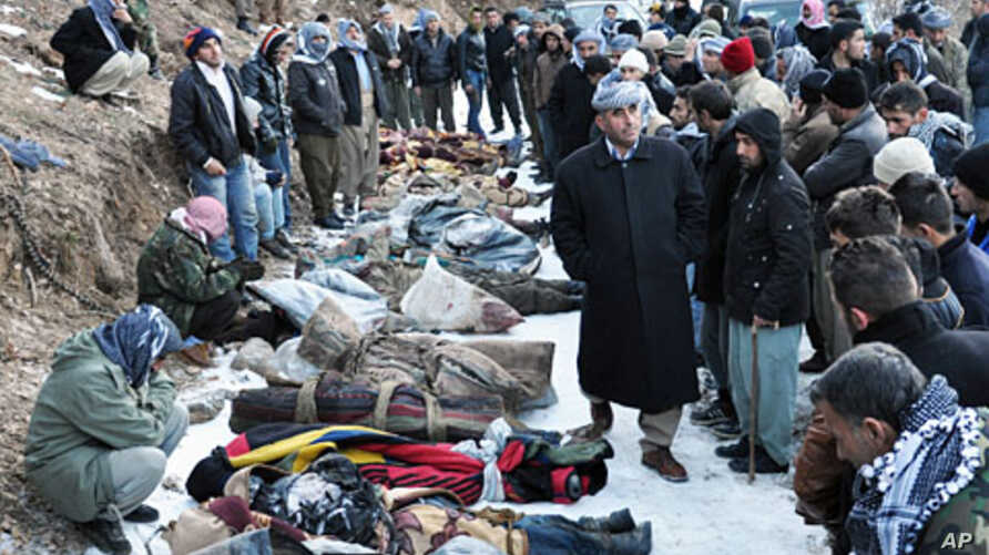 Locals gather in front of the bodies of people who were killed in a warplane attack in the Ortasu village of Uludere, in the Sirnak province, December 29, 2011.