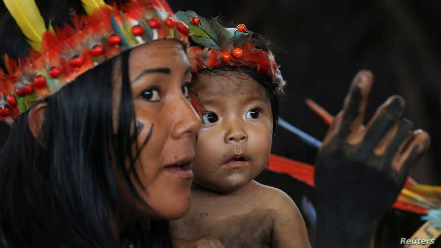 Members of an indigenous group from the Amazon region attend a meeting with Pope Francis at the Coliseo Regional Madre de Dios in Puerto Maldonado, Peru, Jan. 19, 2018.