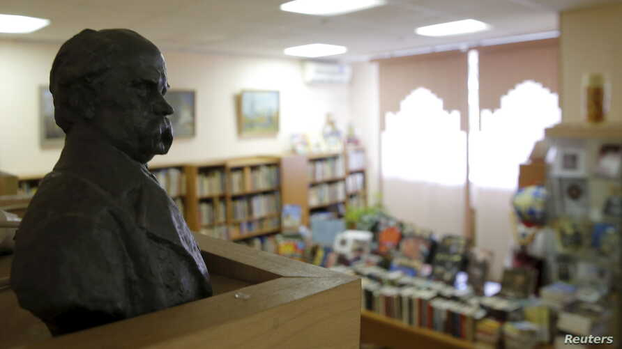 A bust of Ukrainian poet Taras Shevchenko is displayed at the Library of Ukrainian Literature in Moscow, Oct. 29, 2015. Russian officials detained Natalya Sharina, the library director, and are investigating whether she was guilty of inciting ethnic ...