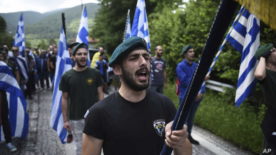 FILE - In this June 17, 2018 file photo, opponents of the deal between Greece and Macedonia on the latter country's new name - North Macedonia - hold Greek flags as they protest in northern Greece. Greece has moved to expel two Russian diplomats over