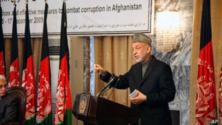 Handout photo of Afghan President Hamid Karzai speaking during an anti-corruption conference in Kabul on 15 Dec 2009