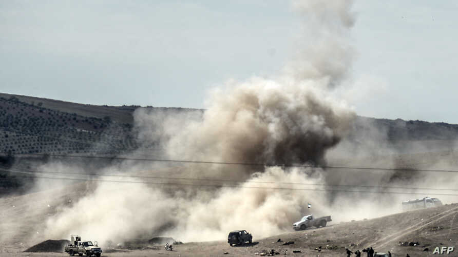 Smoke rises from the Syrian border town of Kobani as Islamic State militants fire mortar shells against Kurdish fighters, as seen from the Turkish border town of Suruc, Nov. 3, 2014.