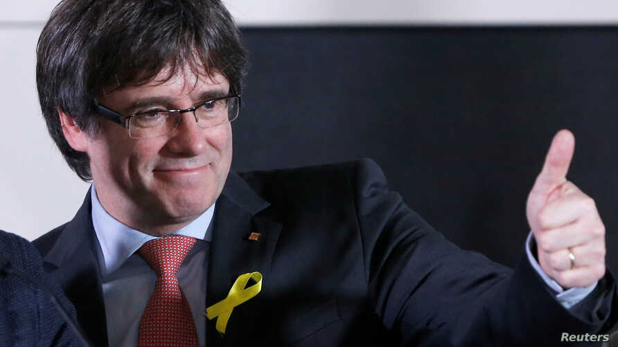 Carles Puigdemont, the dismissed president of Catalonia, arrives to speak after watching the results of Catalonia's regional election in Brussels, Belgium, Dec. 21, 2017.