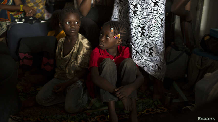 FILE - Children sit inside a container truck as they wait to depart to the west of the CAR, towards the border with Cameroon.
