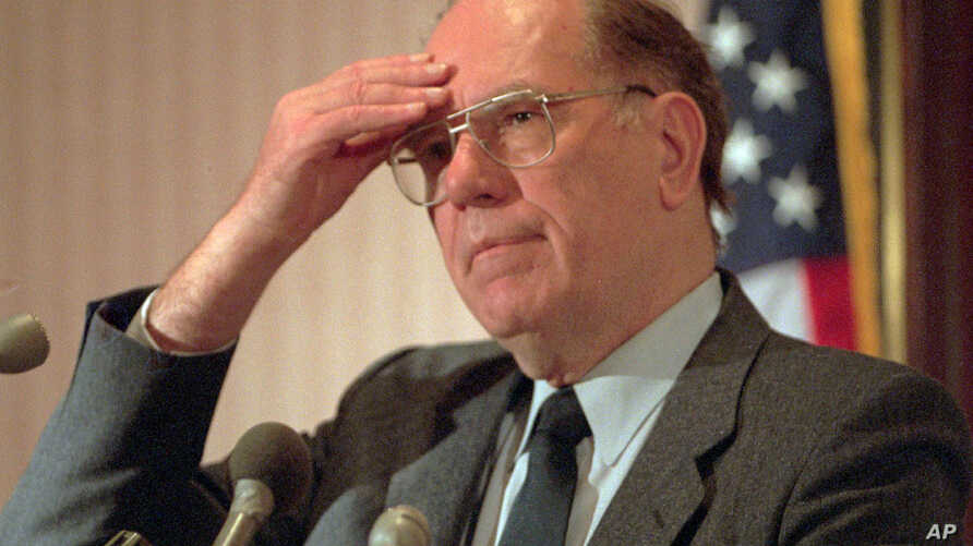 FILE - Lyndon LaRouche gestures during a news conference in Arlington, Va., Feb. 3, 1994.