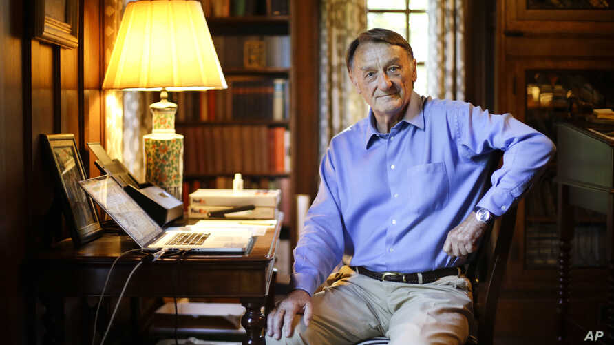 Ghosts of Tennessee retired attorney Jim Emison sits in his home office in Alamo, Tenn., June 10, 2015. In 2012, Emison was researching a story he planned to write about a court case when he came across an online article about two lynchings in 1937 a