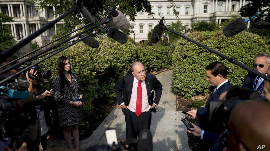 White House chief economic adviser Larry Kudlow speaks to the media after finishing interviews on the North Lawn of the White House, Aug. 16, 2018, in Washington.