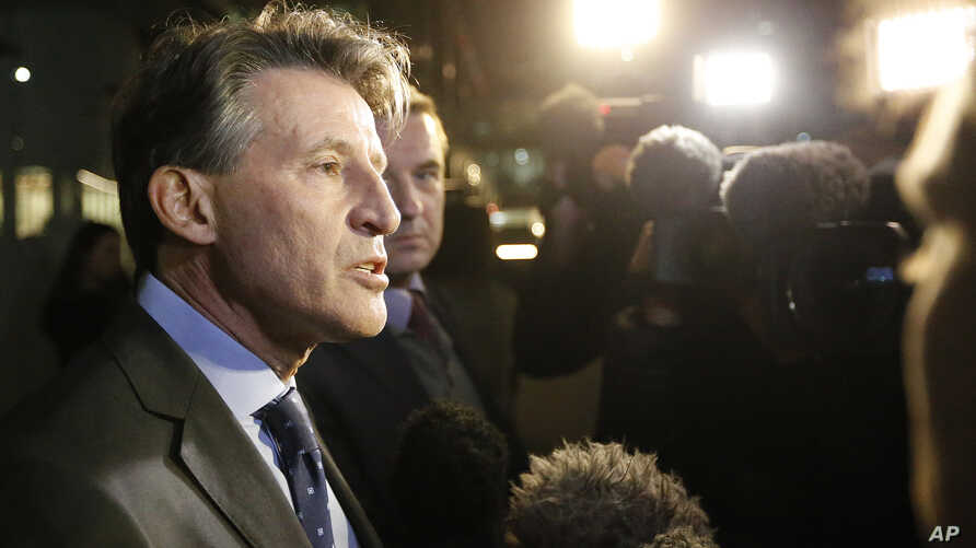 IAAF President Sebastian Coe gives a statement to journalists outside his office in London, Nov. 13, 2015.