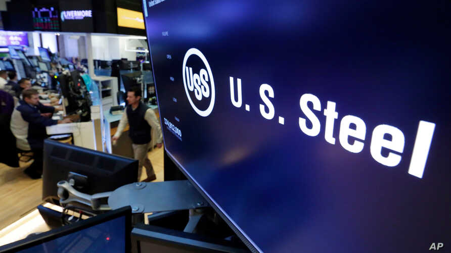 FILE - The logo for U.S. Steel appears on a screen above the trading floor of the New York Stock Exchange, in New York, Oct. 31, 2017.