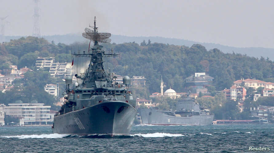 The Russian Navy's frigate Pytlivy, followed by landing ship Nikolai Filchenkov, sails in the Bosphorus, on its way to the Mediterranean Sea, in Istanbul, Turkey, Aug. 24, 2018.