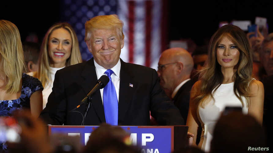 Republican presidential candidate Donald Trump smiles as he speaks at the start of a campaign victory party after rival candidate Sen. Ted Cruz dropped out of the race for the Republican presidential nomination, at Trump Tower in Manhattan, New York,