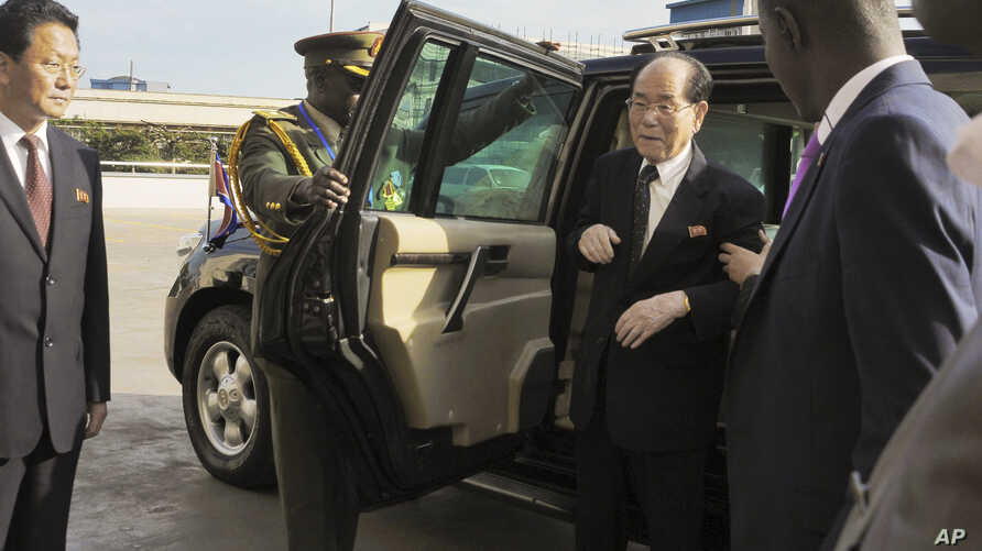 FILE -- In this file photo taken Thursday, Oct. 30, 2014, North Korea's ceremonial leader Kim Yong Nam, center-right, the head of North Korea's parliament, arrives for a visit to Uganda's parliament in Kampala, Uganda. North Korean weapons barred by