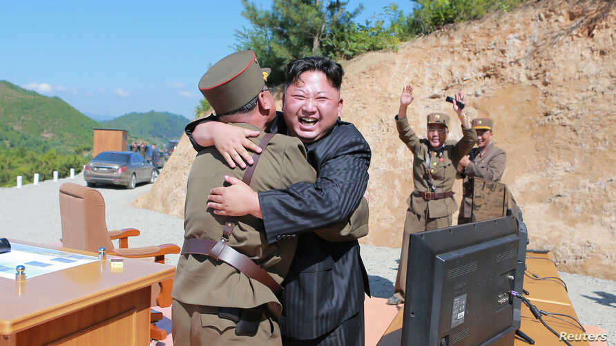 North Korean leader Kim Jong Un reacts with scientists and technicians of the DPRK Academy of Defence Science after the test-launch of the intercontinental ballistic missile Hwasong-14 in this undated photo released by North Korea's Korean Central Ne