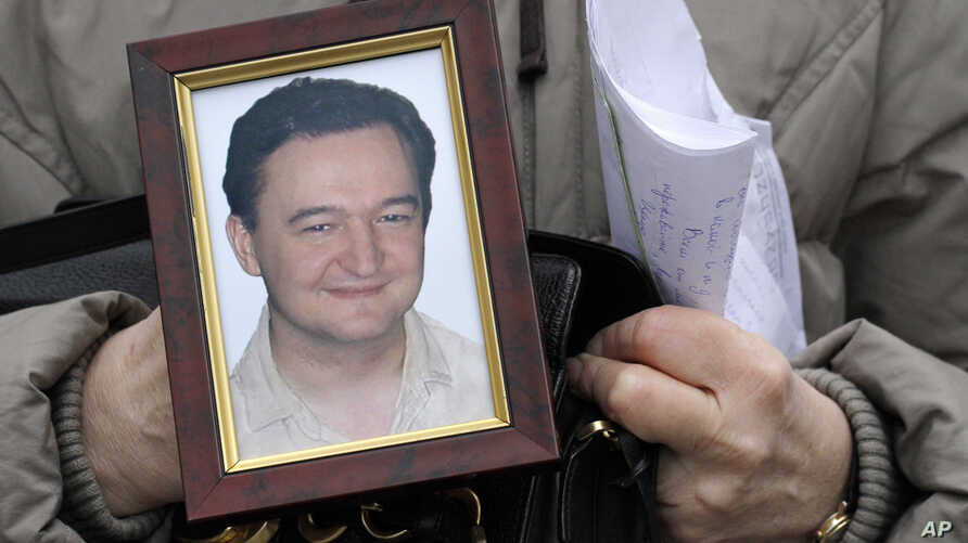 File photo a portrait of lawyer Sergei Magnitsky who died in Russian jail. The US Senate is taking up legislation that would end four-decade-old trade restrictions that are blocking U.S. businesses from enjoying the benefits of a more-open Russian ma