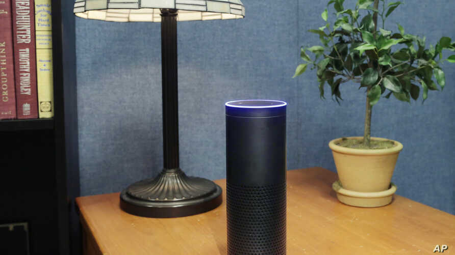 FILE - Amazon's Echo, an Alexa-compatible digital assistant that continually listens for commands such as for a song, a sports score or the weather, is pictured in New York, July 29, 2015.
