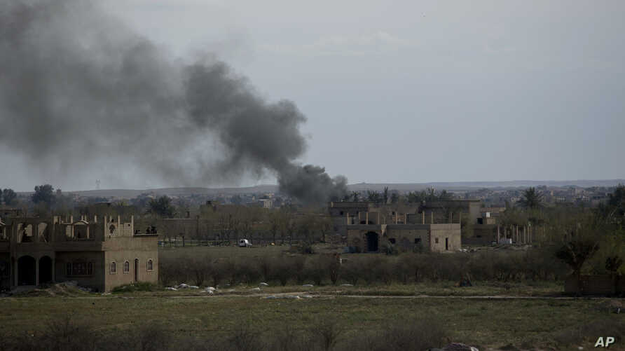 Smoke rises from a strike on Baghuz, Syria, on the Islamic State group's last piece of territory on March 22, 2019.