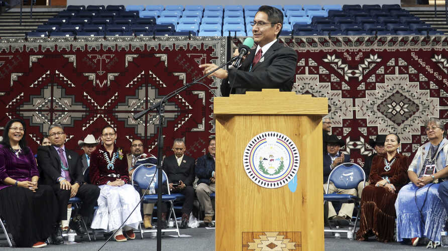 Jonathan Nez addresses a crowd after he's sworn in as president of the Navajo Nation on Tuesday, Jan. 15, 2019 in Fort Defiance, Ariz.