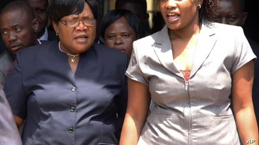 Zimbabwean deputy President Joice Mujuru, left, leaves the Harare magistrates court accompanied by her daughter Kumbirai in Harare,  January 17, 2012