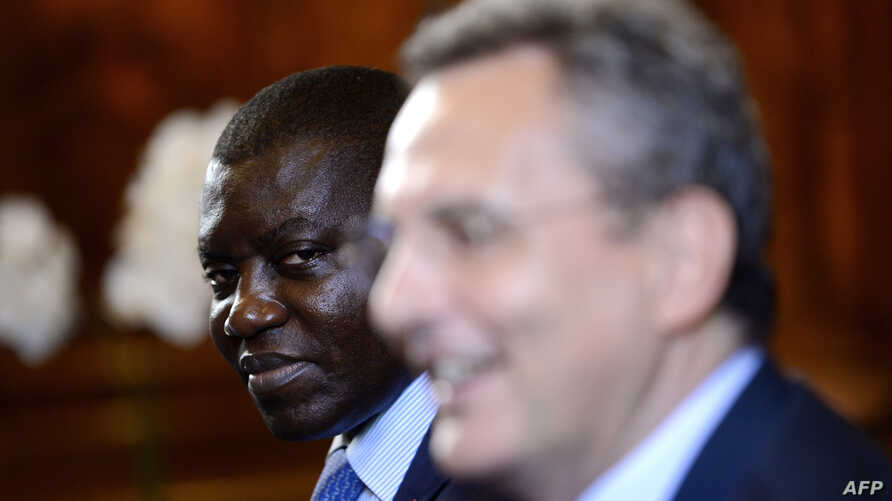 Republic of Central Africa Foreign Minister Charles Armel Doubane (L) looks on as Sant'Egidio organization president Marco Impagliazzo addresses a political delegation from Central African Republic, June 19, 2017, inside the Sant'Egidio community chu