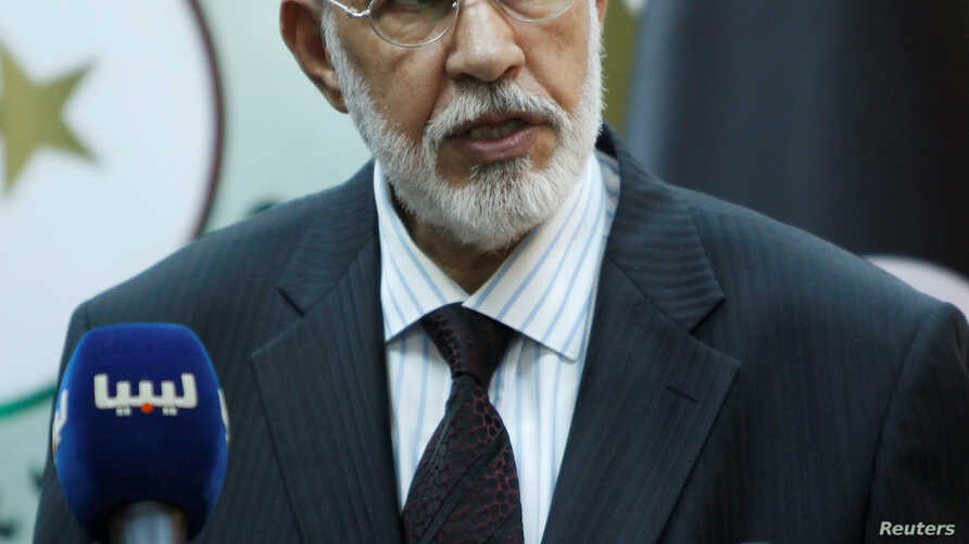"""FILE - Mohammed Siyala, foreign minister in Libya's U.N.-backed national unity government, speaks during a news conference in Tripoli, May 30, 2016. Siyala called U.S. President Donald Trump's travel ban an """"unjust decision"""" that should be reviewed."""