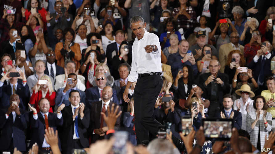 Former President Barack Obama reacts as he walks on stage at a rally in support of candidate for Senate Jacky Rosen and other Nevada Democrats, in Las Vegas, Oct. 22, 2018.