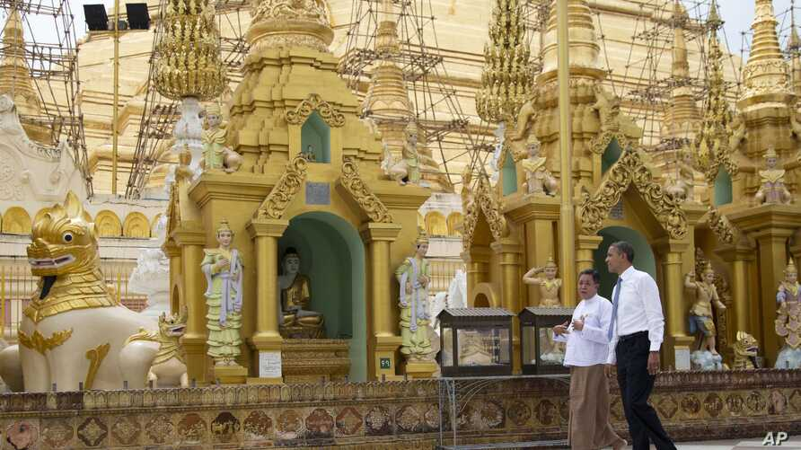 President Barack Obama, right, tours the Shwedagon Pagoda in Rangoon, Burma, November 19, 2012.