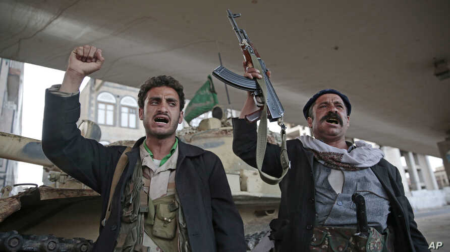 Houthi Shiite fighters chant slogans as they guard a street leading to the residence of former Yemeni President Ali Abdullah Saleh, in Sanaa, Yemen, Dec. 4, 2017.