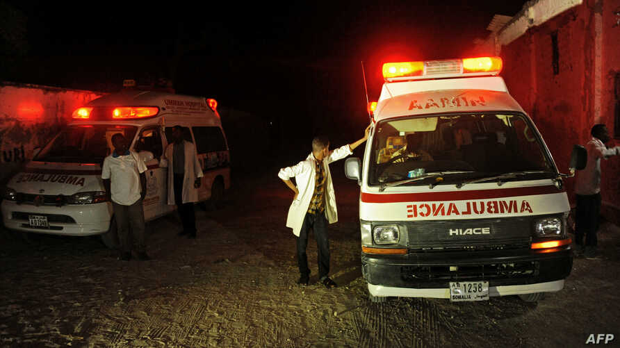 Two ambulances stand on the scene of a bomb attack at Lido Beach, in Mogadishu, Somalia, Jan. 21, 2016.