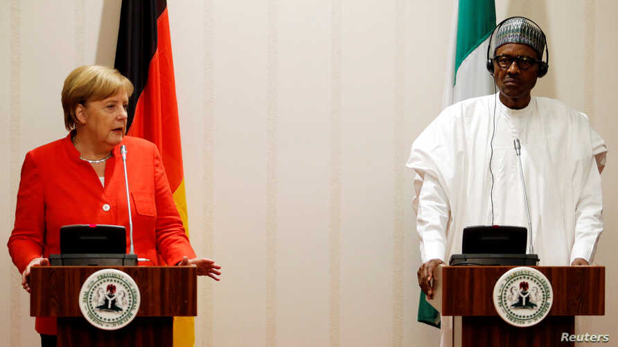 German Chancellor Angela Merkel and Nigeria's President Muhammadu Buhari address a news conference at the presidential villa in Abuja, Nigeria, Aug. 31, 2018.
