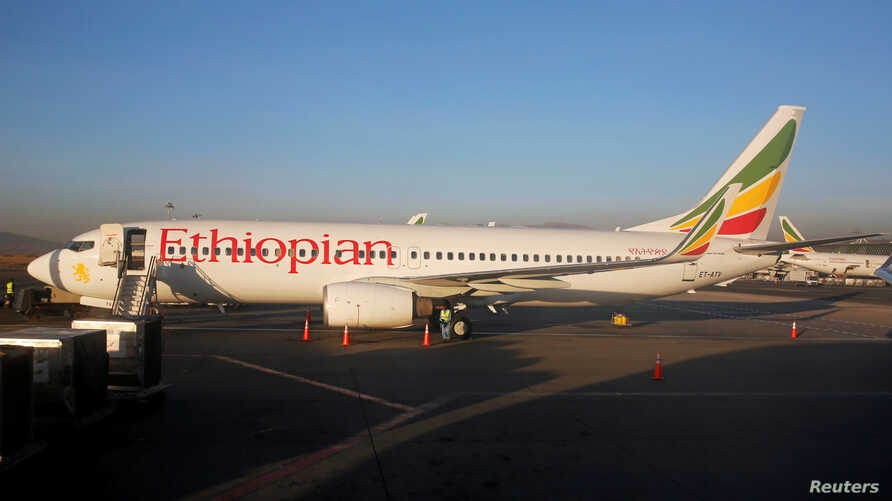 FILE - Workers service an Ethiopian Airlines Boeing 737-800 plane at the Bole International Airport in Ethiopia's capital Addis Ababa, Jan. 26, 2017.