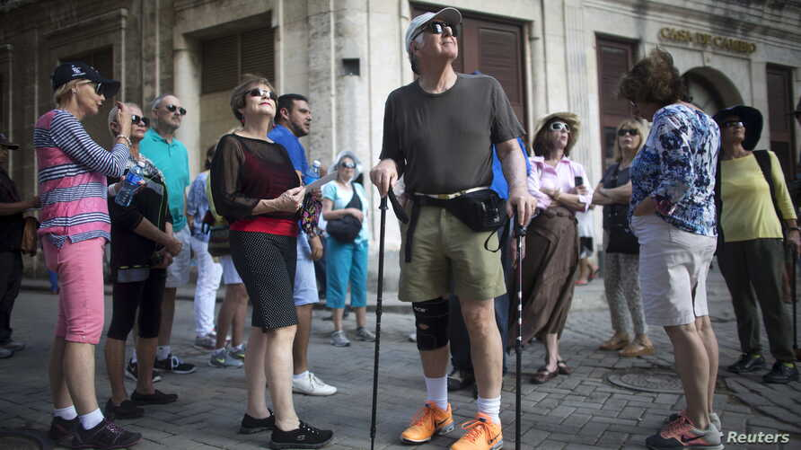 American tourists look around during a tour at old Havana, Cuba December 14, 2015.