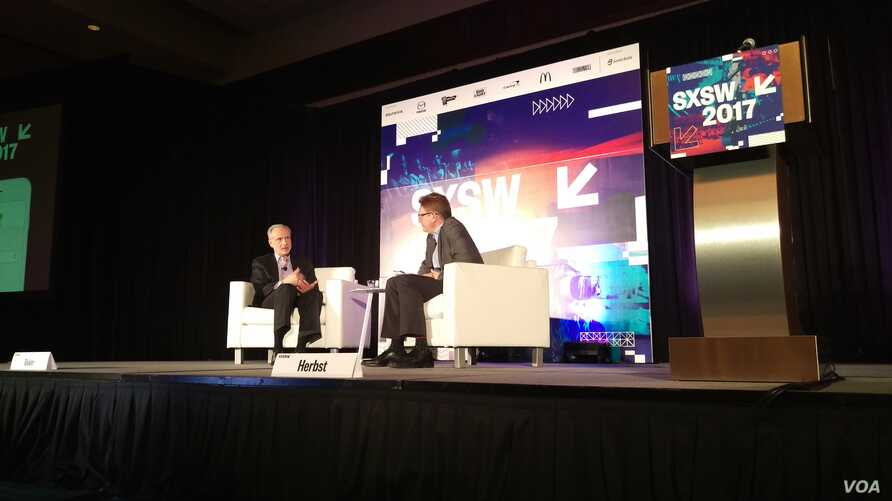 FBI General Counsel James Baker (left) is interviewed by Newseum CEO Jeffrey Herbst (right) during the South by Southwest (SXSW) Conference & Festivals in Austin, Texas. (T. Trinh/Facebook)
