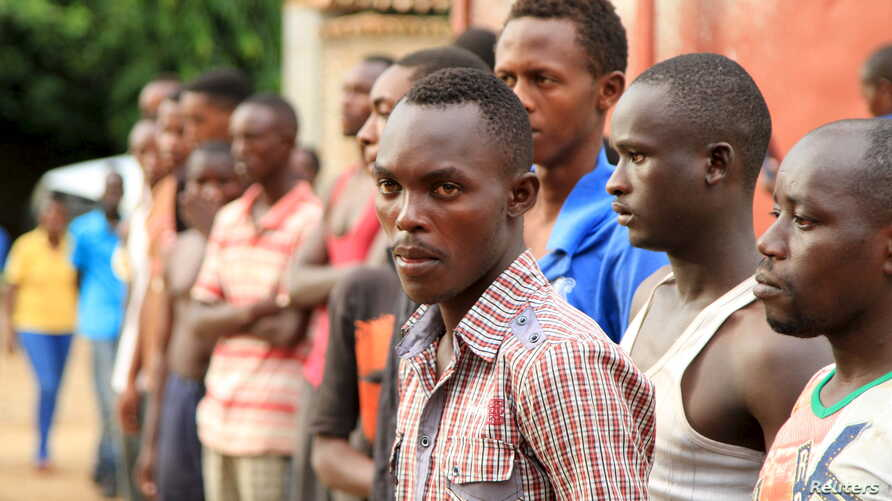Suspected fighters are paraded before the media by Burundian police after clashes in the capital Bujumbura, Burundi, Dec. 12, 2015.